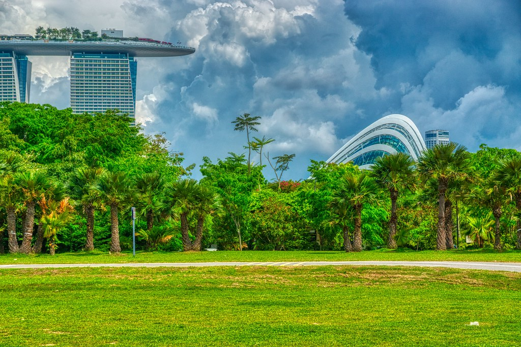Gardens by the Bay with Marina Bay Sands hotel and storm clouds in Singapore