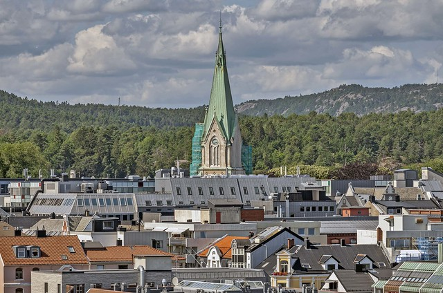 The cathedral protrudes above other roofs