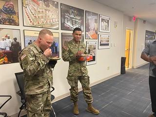 Soldiers enjoying Kerlara Curry's Chicken Curry, and Vindalbo sauce.