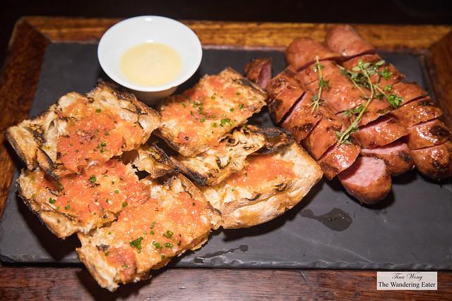 Butifarra Catalan-Style Pork Sausage and Grilled pan de cristal, fresh tomato, honey aioli