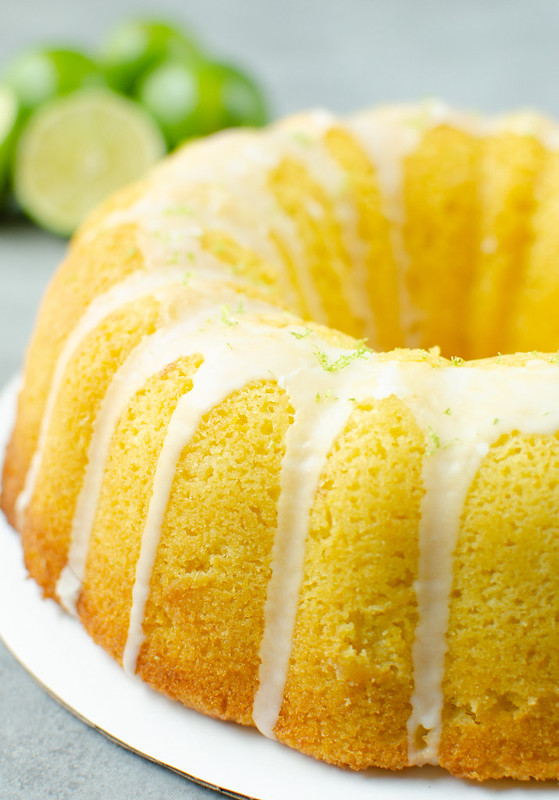 Margarita bundt cake with glaze and lime zest on top. Limes in the background.