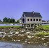 This building, on stilts as it appears, perhaps at low tide in the area of Cape Porpoise