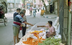 Buying Flowers , Early Morning in the streets of Kolkata, India.