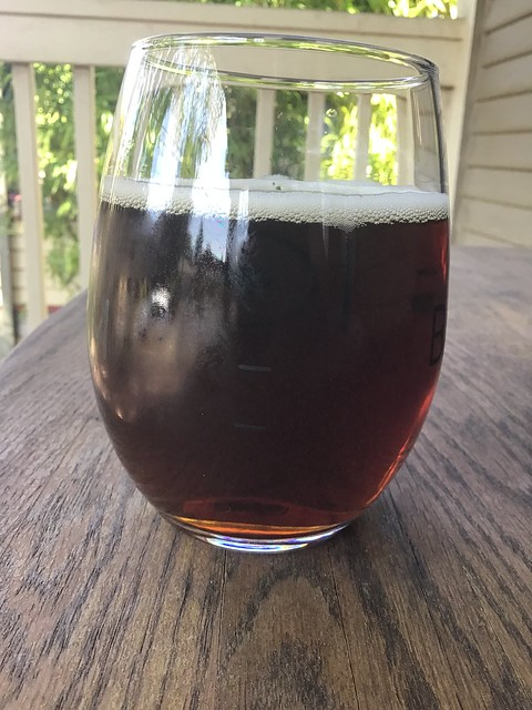 Ridgeback Red ale from Block 15 in glass on table outside