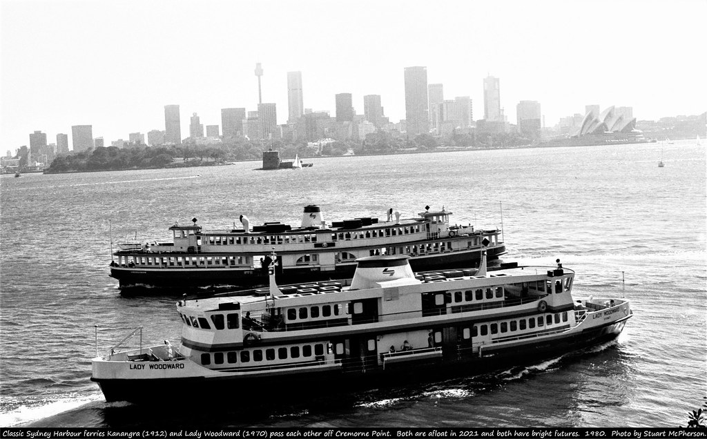 The classic Sydney Harbour Ferries Kanangra (built in Sydney 1912) and Lady Woodward (built in Newcastle 1970) pass one another off Northern Sydney's Cremorne Point in a classic Sydney Harbour scene.  Remarkably, both of these Australian-built vessels are still afloat - with Lady Woodward now being 51 years of age and the historic Kanangra not all that far off 110!  Kanangra is currently under restoration by the Sydney Heritage Fleet in Rozelle Bay - whose intention it is to restore her to full operating condition on Sydney Harbour.   Prior to this she requires major hull work - and to this end it is hoped that she be finally out of the water in the relatively near future.  Lady Woodward is privately owned - and her competent and capable owner offers this solid and wonderful vessel a promising future.  Stuart McPherson photo.    1980.