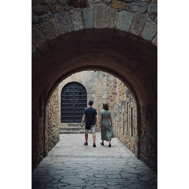 Modern couple wandering through a medieval village