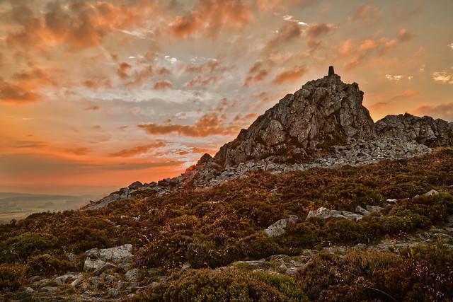 Sunset behind Manstone Rock