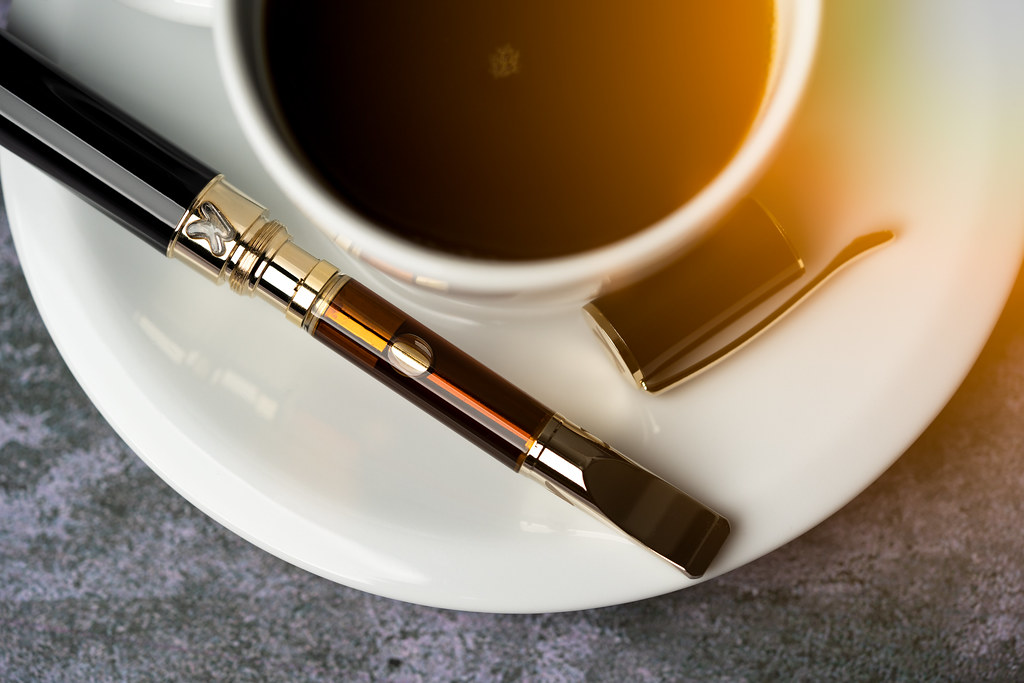 Weed Pen next to a Coffee