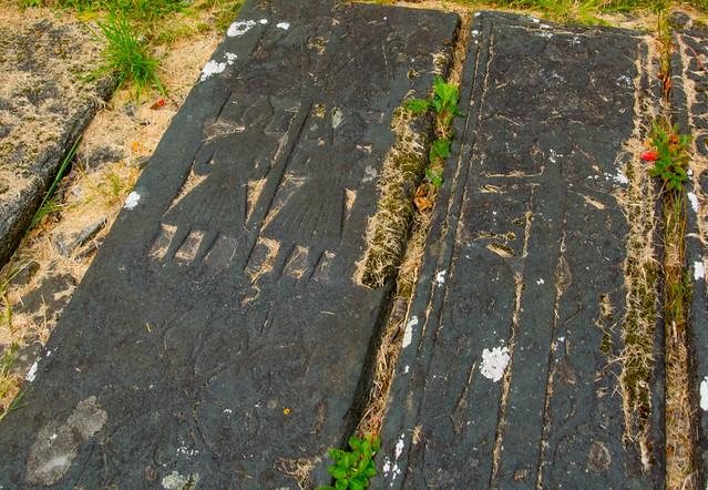 Carved warrior graveslabs