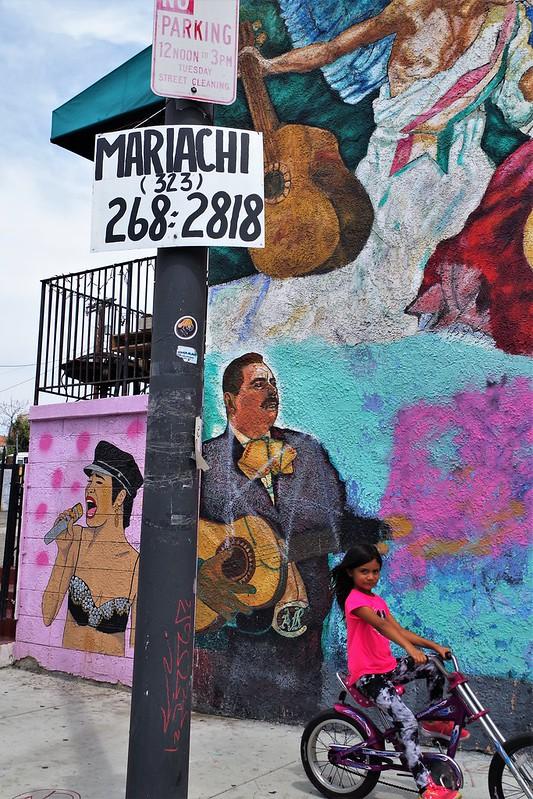 Girl riding by me -  Mariachi Plaza E. L.A.