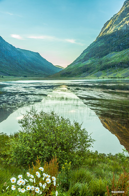Sunrise and mountain relected in the waters of Loch Achtriochtan, Glencoe, Argyll, Scotland at 06:18.
