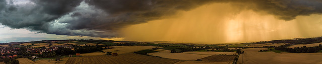 thunderstorm in front of sunset