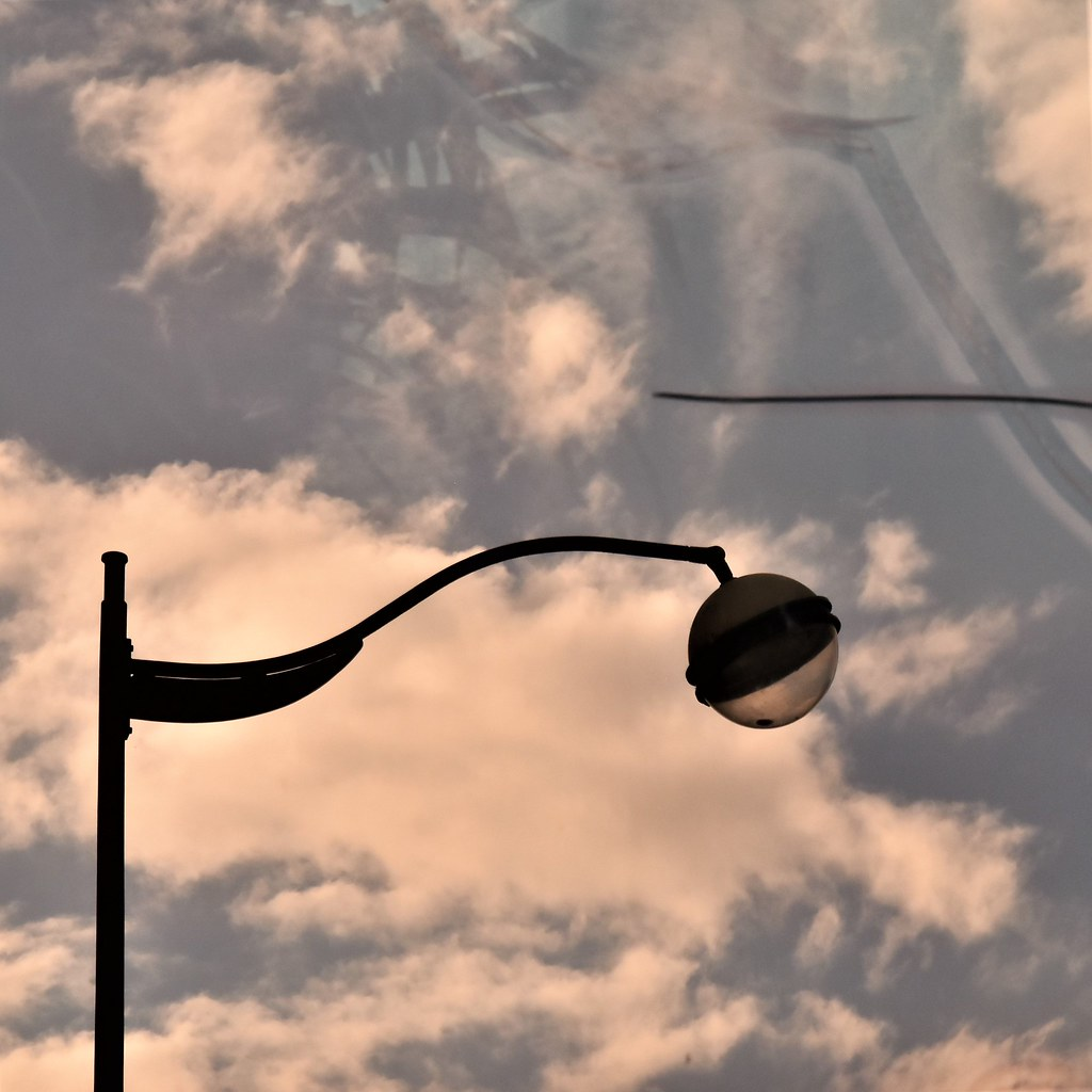 Street lamp and sky reflection on a broken glass
