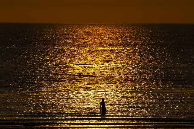 Silhouette of a girl in the sea