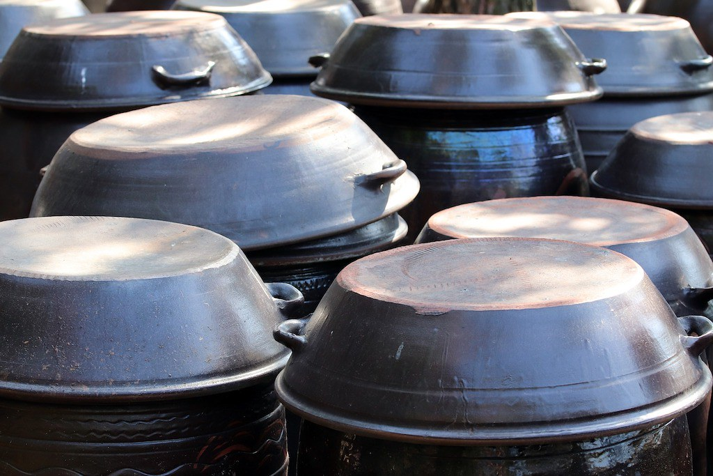 a photo of traditional Korean onggi--jars used before the kimchi refrigerator was invented.