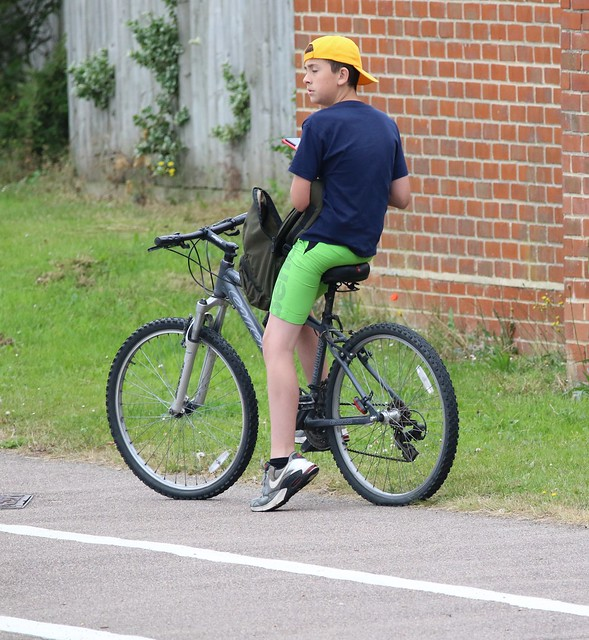 Yellow hat..  Green shorts