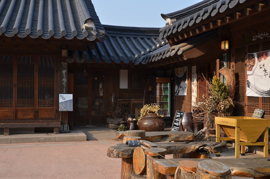 A traditional Korean home with an earthenware pot outside the door.