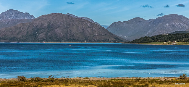 View west across Loch Linnhe to the remote and rocky mountains of Ardgour from near to North Ballachulish and Ballachulish Bridge, Argyll, Scotland.