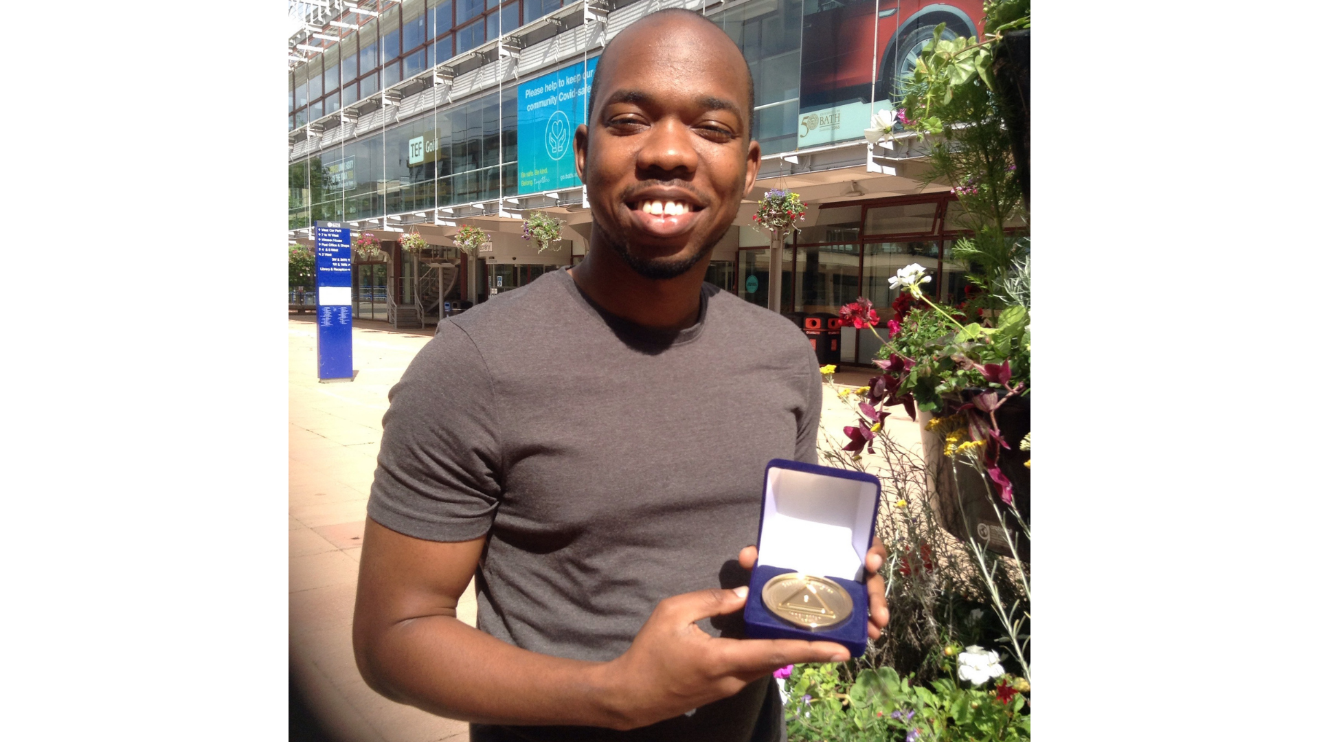 Sanjae King, holding a medal of achievement
