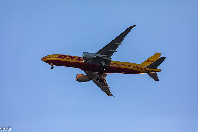 With Australia's dire need for Pfizer Covid vaccines, today's dusk DHL Boeing 777 approaches Sydney airport from Los Angeles - hopefully with supplies, Sydney, New South Wales, Australia