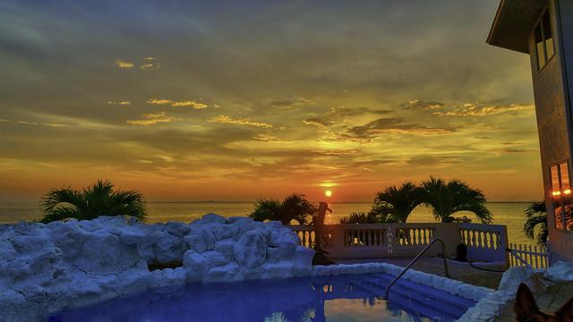 Radiant Red Glowing Gold Stunning Sunset Spans Skies & Seas Scene - IMRAN™