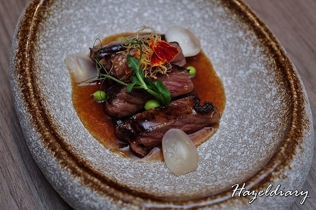 Si Chuan Dou Hua-Pan Fried A4 Wagyu Beef served with Si Chuan Green Chili