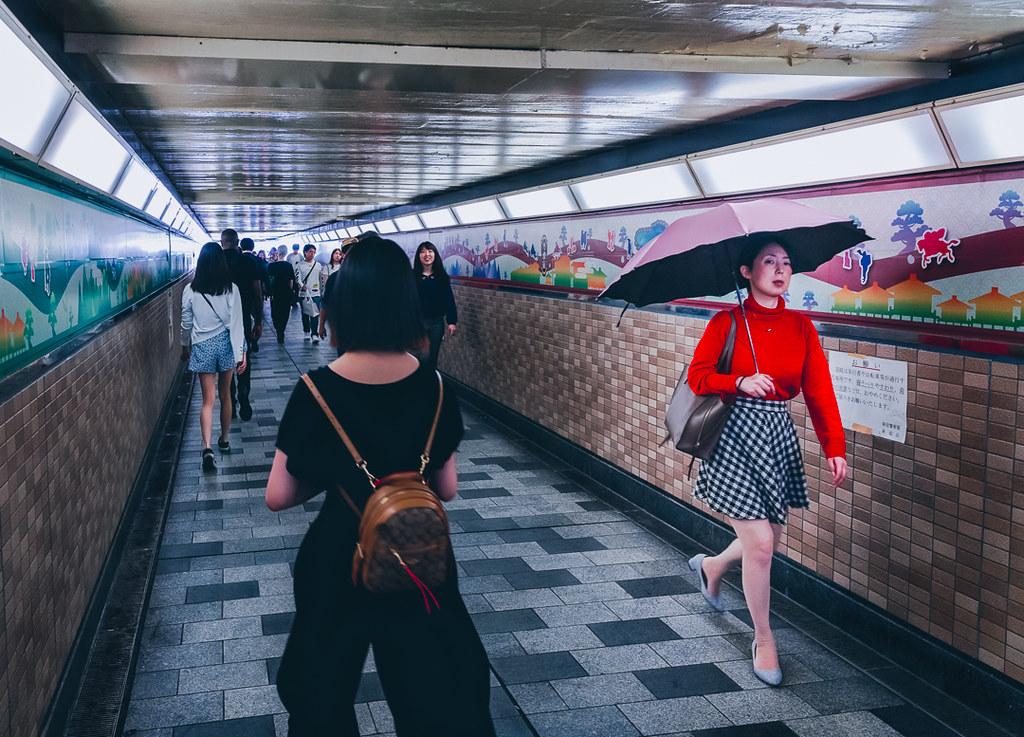 Shinjuku railway underpass Woman in Red