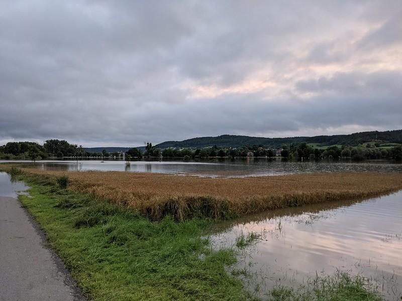 Flooded footpath through flooded fields