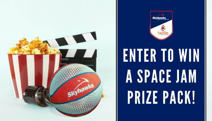 Banner that says enter to win a Space Jam prize pack! Beside the banner is a red and blue Skyhawks basketball, a white and rad striped popcorn bucket with popcorn inside, a reel of film and a movie marker in the background.