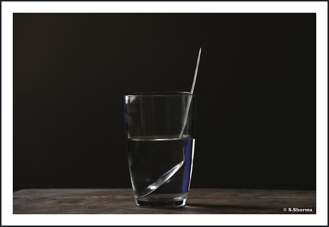 Water glass and spoon