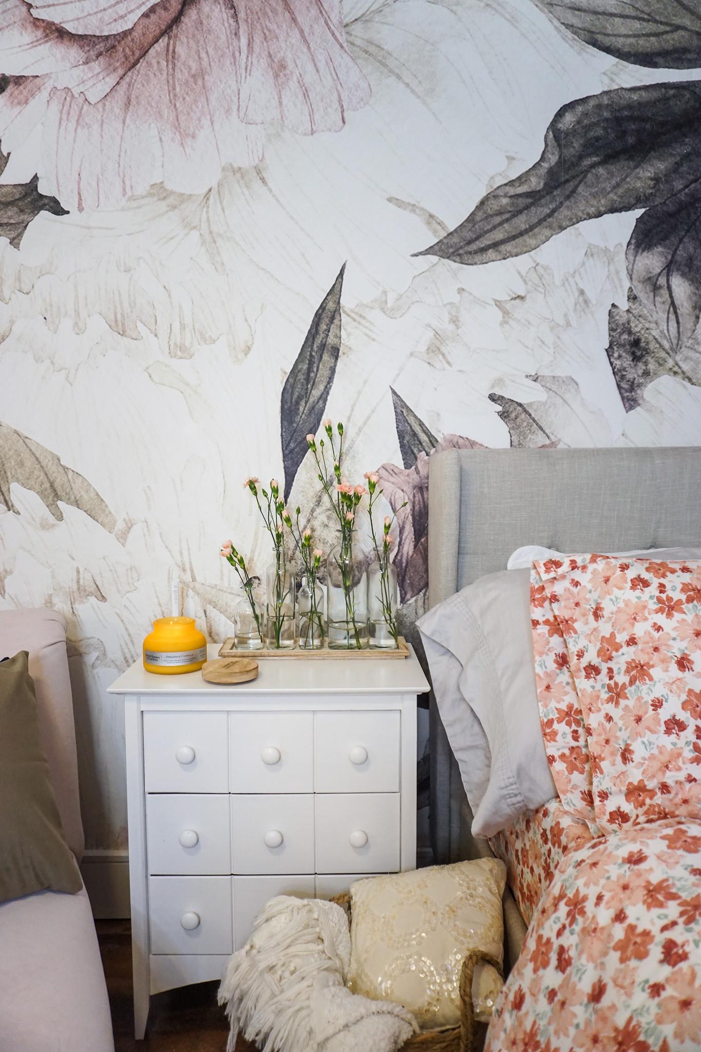 5 Ways to Freshen Up Your Bedroom this August   Bedroom Ideas   Boho Bedroom   Floral Mural Wallpaper   Pink Bedroom   Feminine Bedroom Inspiration   Flower Sheets   Vintage Bottle Vase Set