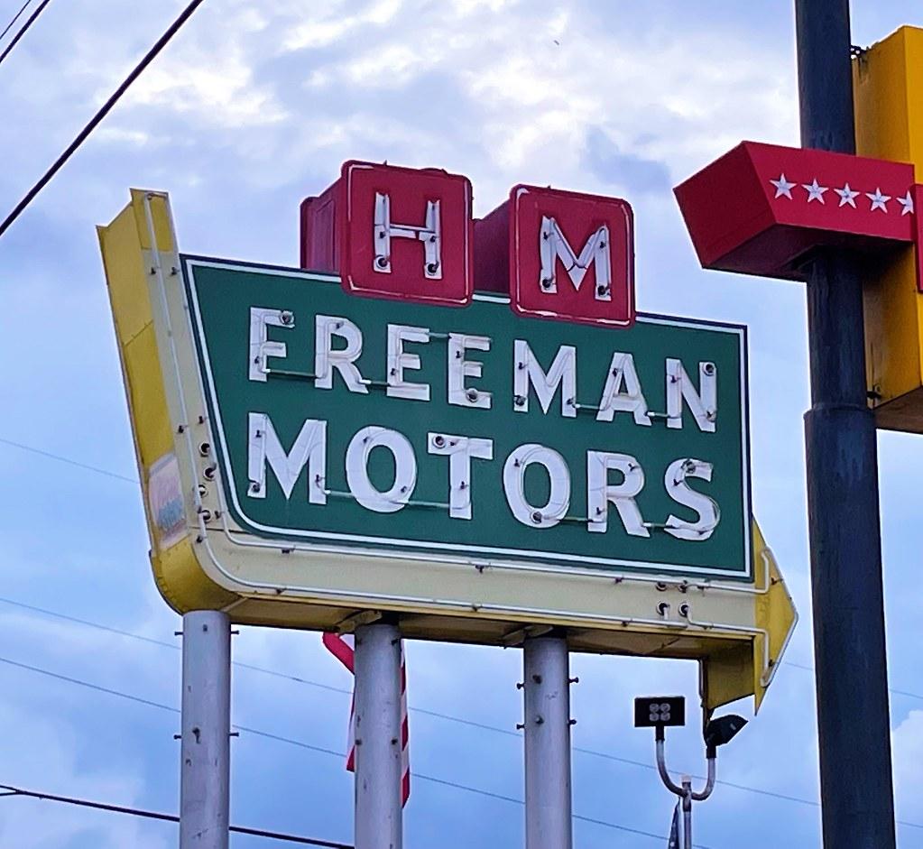 H M Freeman Moters sign
