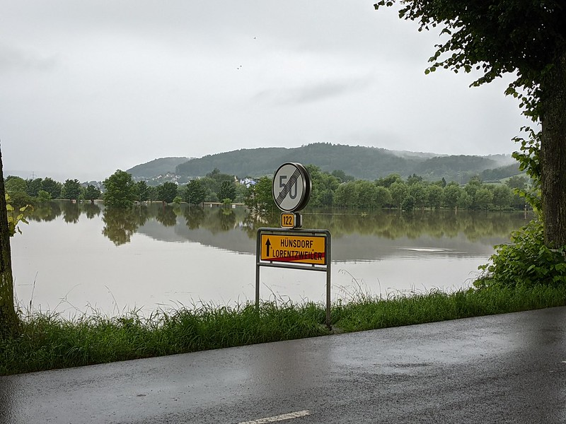 Flooded fields behind road sign