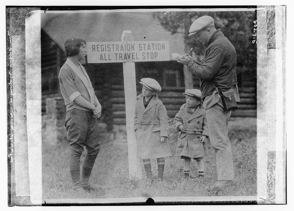 Tom Gibbons registering at entrance, Glacier Park (LOC)