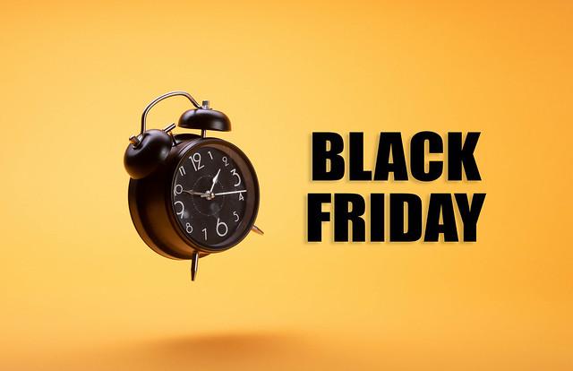 Alarm clock with Black Friday text on orange background