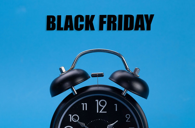 Alarm clock with Black Friday text on blue background