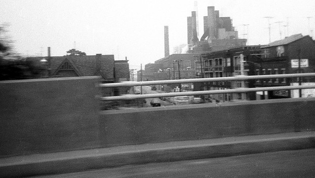 A view from my dad's car on the Connecticut Turnpike. The old UI power plant and the neighborhood surrounding it on Bridgeport's East Main Street. The plant was imploded in 1996. Nothing exists here anymore. It's just a giant empty field. July 1972.