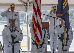 BREMERTON, Wash. (July 29, 2021) Capt. Max Clark, left, and Capt. Craig Sicola salute as Sailors presents the colors during a change of command ceremony aboard USS Nimitz (CVN 68). Sicola relieved Clark as commanding officer of the aircraft carrier. Nimitz is in port preparing for future operations. (U.S. Navy photo by Mass Communication Specialist 3rd Class Elliot Schaudt)
