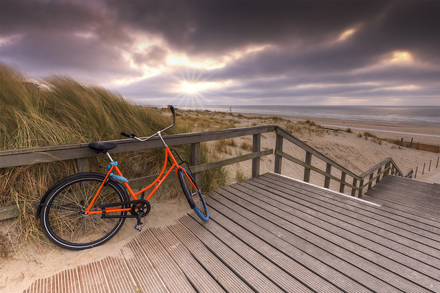 Bicycle on Wooden Stairs to the Beach