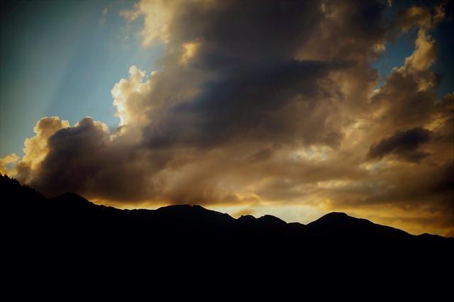 cloud kisses the mountains