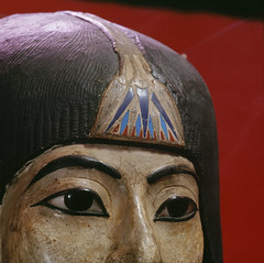 A mummy mask of a women wearing an elaborate collar and a heavy wig adorned with a lotus blossom. Ancient Kemet. 18th dynasty c 1550 1295 BC. (Photo by Werner Forman/Universal Images Group)