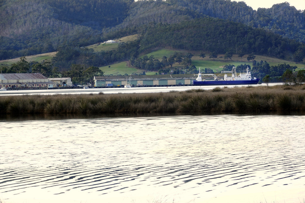 """""""The  world's most loved salmon"""" Ship backstopped by  spectacular  scenery seen from near Port Huon"""