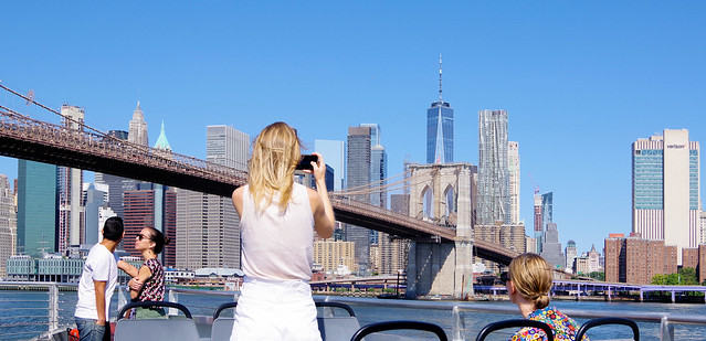 One couple Smooching, one Shooting, one sight seeing & one taking it all it.