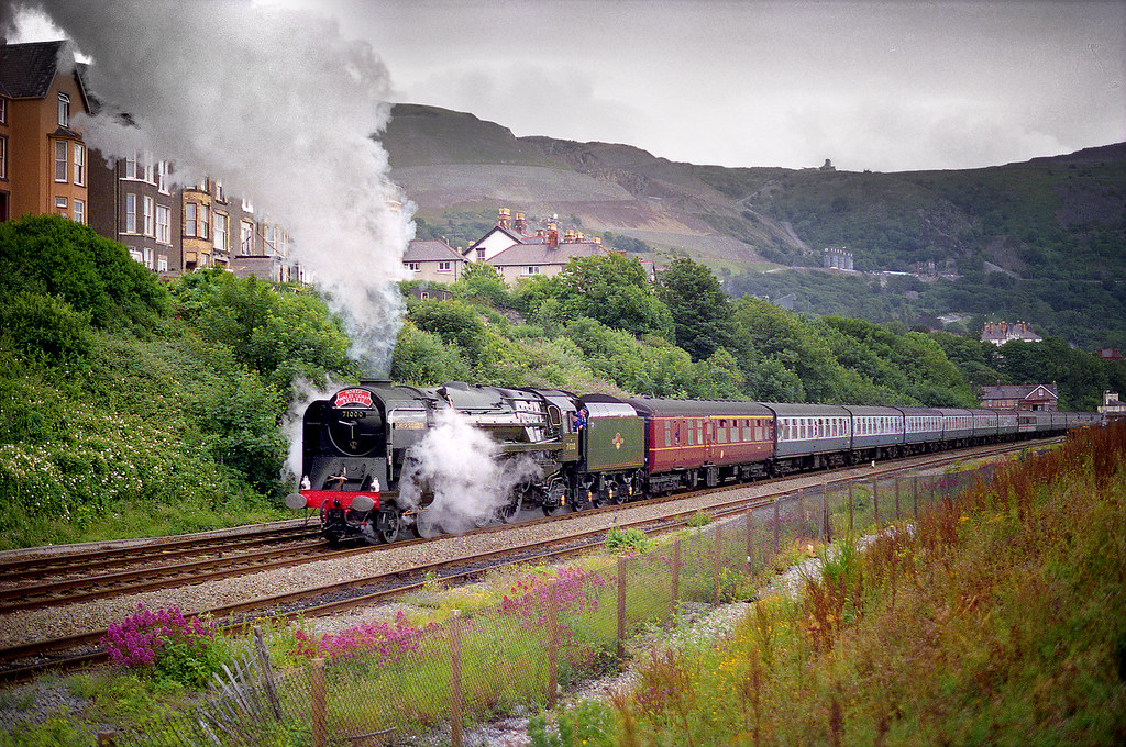 """71000 """"Duke of Gloucester"""" on the North Wales Coast at a location i have forgotten looks to be struggling with 13 on!,..........Scanned image."""