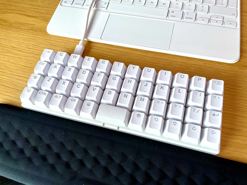 White Planck keyboard on wooden desk