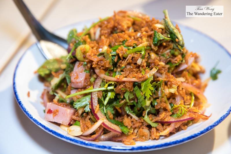 Moo Sadoong or 'startled pig' - Grilled pork, Thai basil, lemongrass, garlic, fish sauce, lime, chili, onions, cilantro, rice powder