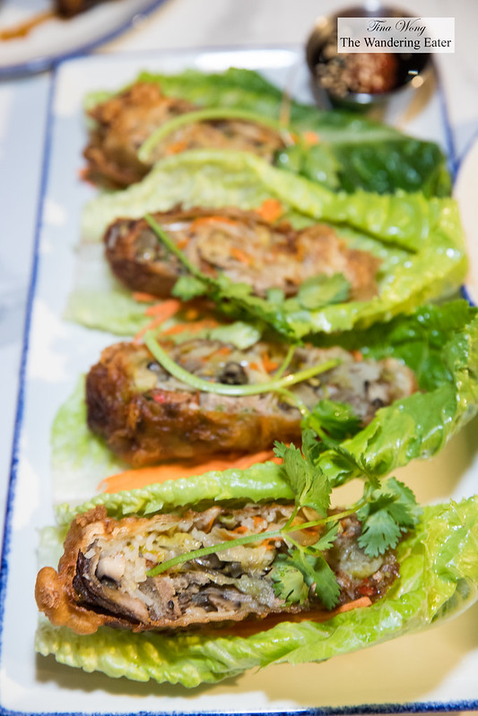Spicy duck rolls - crispy rolls of roast duck, veggies, thai basil and chili. wrap with crunchy lettuce and eat like a taco