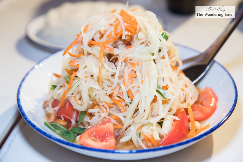 Som Tum (papaya salad) - Mortar- pounded green papaya salad with palm sugar, lime juice, bird eye chili,peanuts