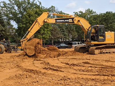 Jon digging a hole with an excavator / backhoe