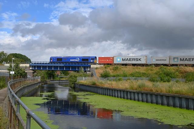 DB 66148 'Maritime Intermodal 7' hauls the 10.04 Wakefield Europort - Felixstowe South Intermodal across the River Gipping, at Boss Hall Jct, Ipswich. 30 07 2021